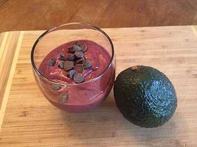 deep purple avocado smoothie in glass